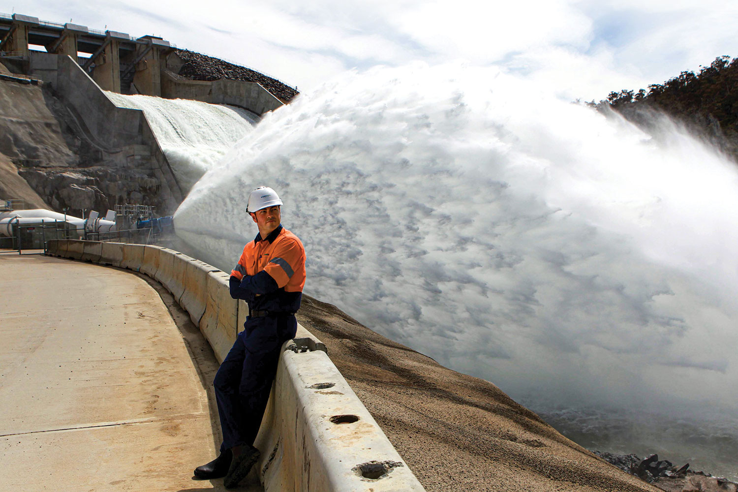 Project Director Kieran Cusack looks on as some of the scheme's 84,000 ML of water surges past. (Image: Newspix/Sam Mooy)