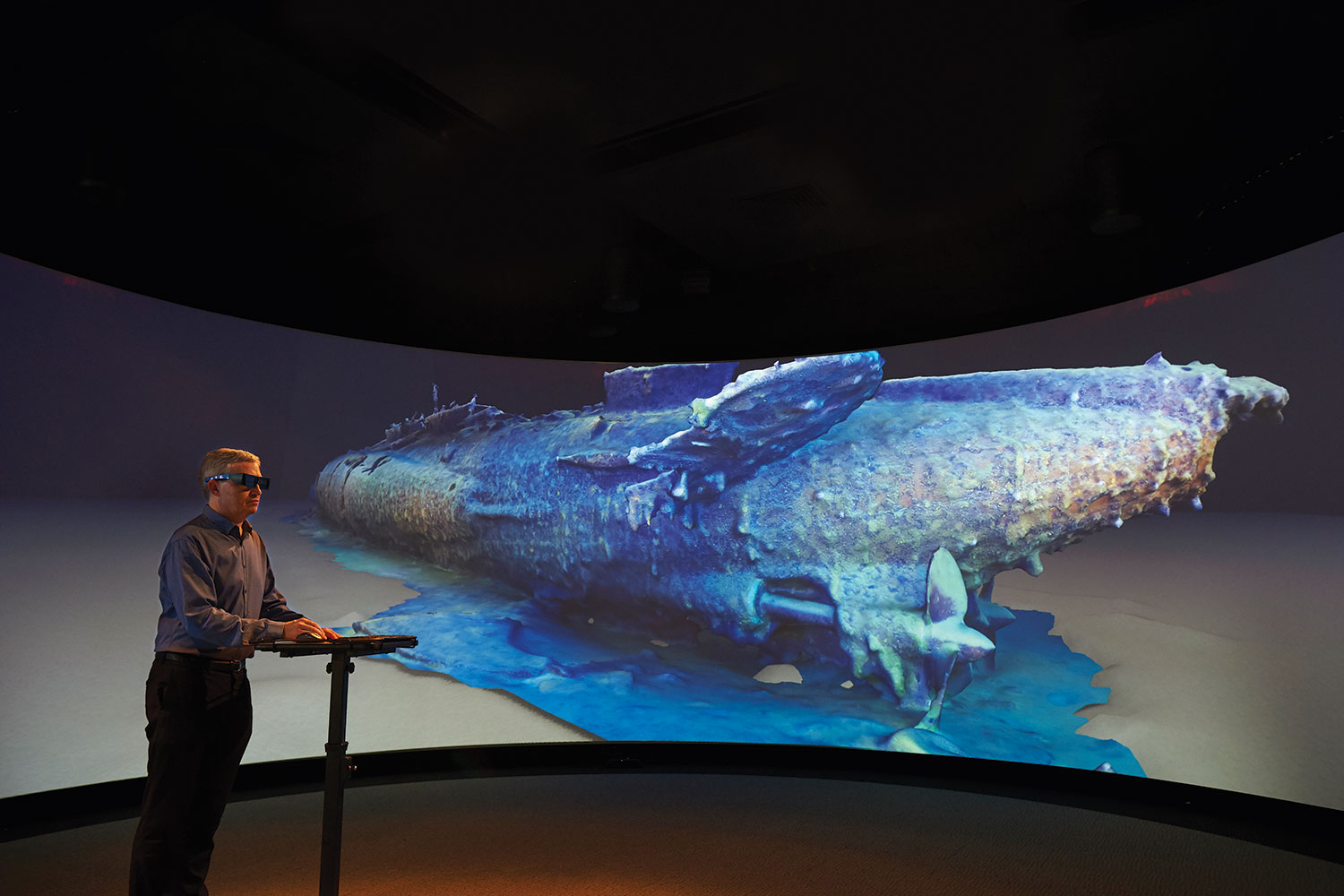 A digital reconstruction of the HMAS AE1 displayed on the HIVE cylinder. (Screen content: Paul G Allen, Find AE1 Ltd, ANMM and Curtin University)