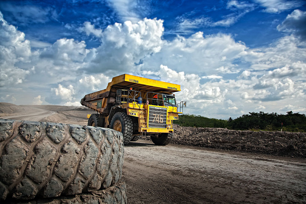 Measures employed by the mining industry to govern the flow of essential interstate workers could be adopted more widely.