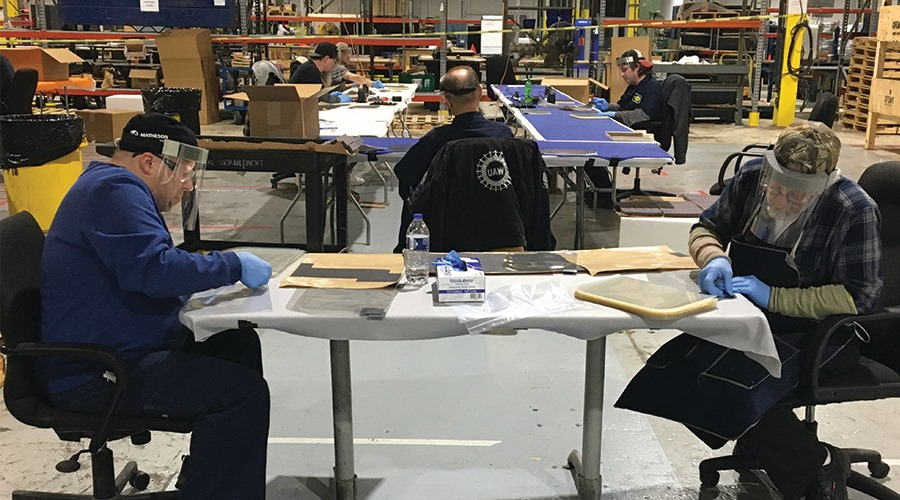 Workers at Ford subsidiary Troy Design and Manufacturing assemble face shields based on an open source design. Image: Troy Design and Manufacturing