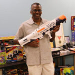 Then and now: Lonnie Johnson with his invention.