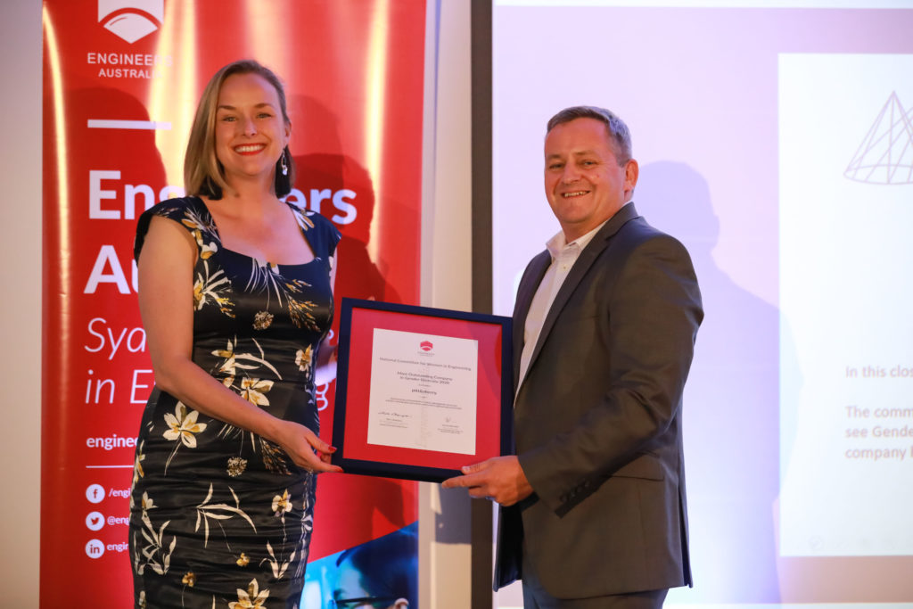 pitt&sherry CEO Benita Husband FIEAust CPEng accepting the award from Engineers Australia New South Wales Greg Ewing.
