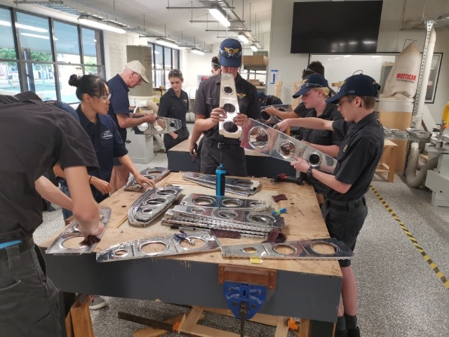 Students with their aircraft parts