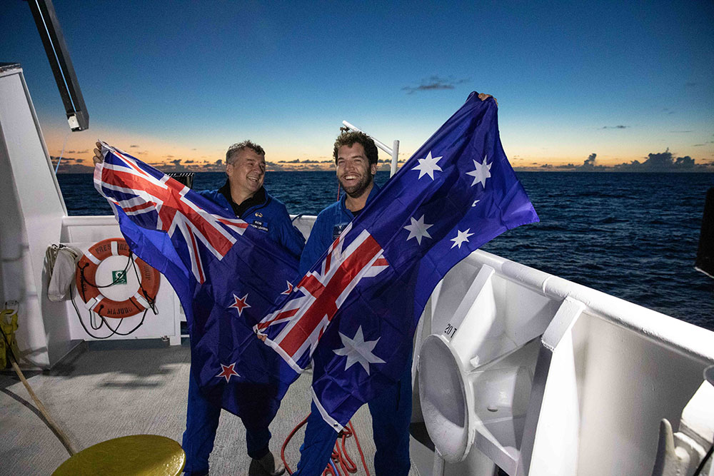 Tim Macdonald and Rob McCallum return to the surface after setting a depth record for Australia and New Zealand.