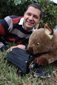 Robert Ross with WomBot the wombat robot.