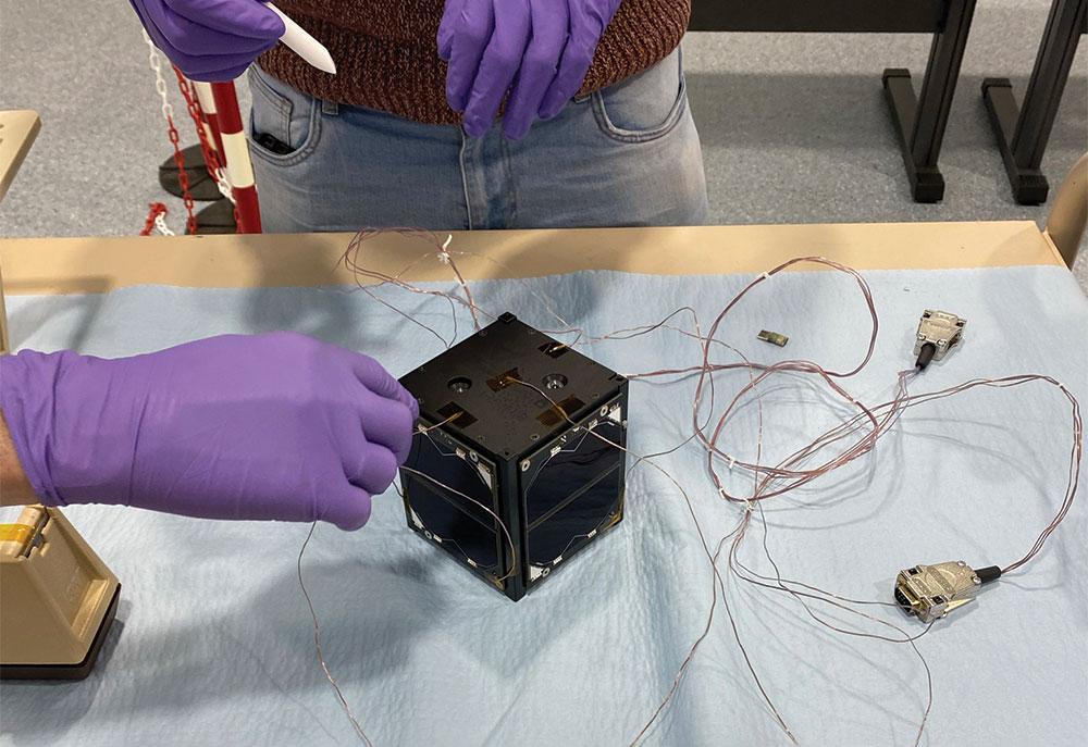 Preparing for a thermal vacuum test.